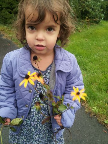 Flowergirl with last flowers of summer