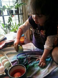 Flowergirl dipping Easter eggs